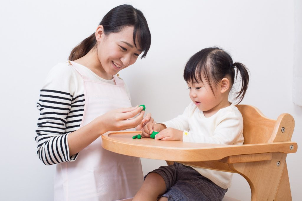asian young woman and kid