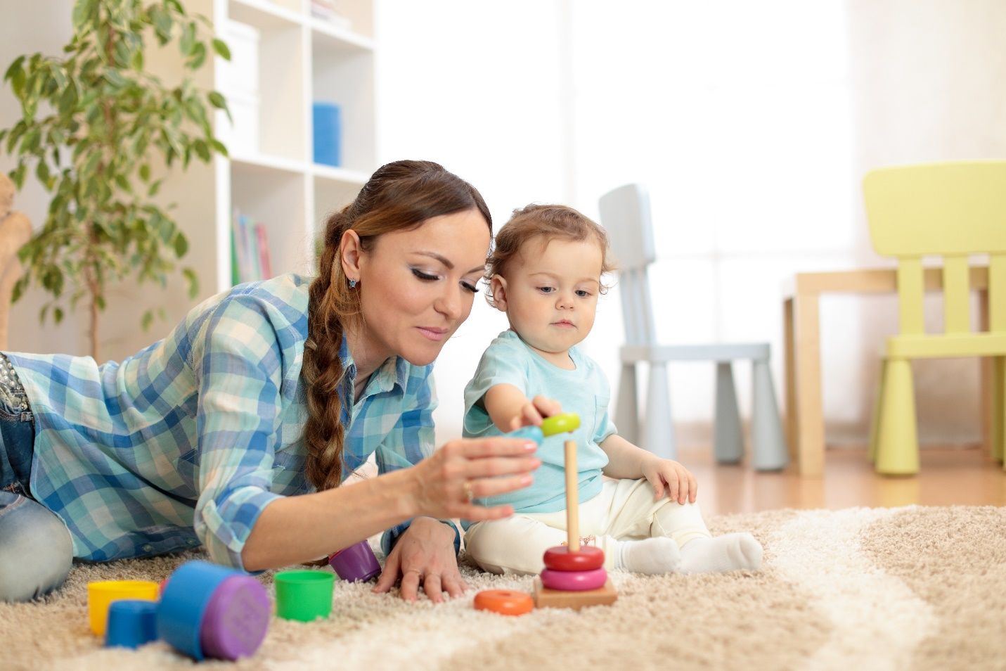 baby and mother playing toy rings