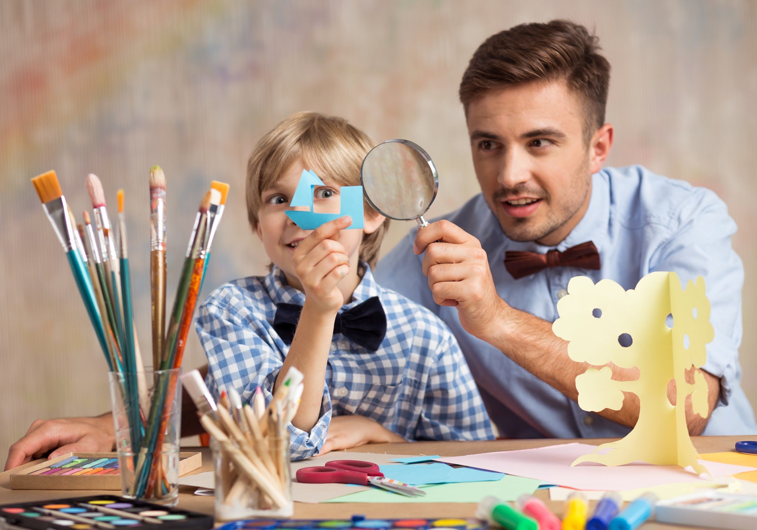 creative male babysitter during play with child