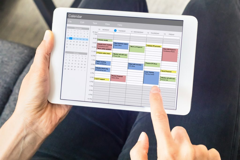 Calendar app on tablet computer with planning of the week with appointments