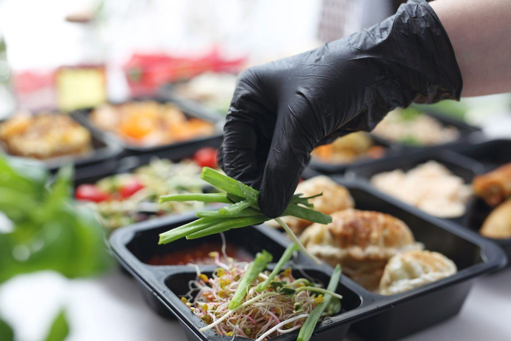 the chef prepares a meal in a boxed diet